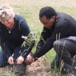 Father Henry and Meece planting trees in Kenya.
