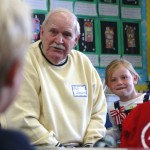 Bill Hemans, a Korean War Navy veteran, and his granddaughter, Samantha, listen to a question from a student during the Mariner's Elementary School Veterans Day celebration. —Photos by Sara Hall