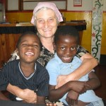 "Lynn ""Mama Lynn"" Elliott with two of the children under the care of her Light in Africa organization."