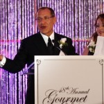 Honoree Julian Movsesian, with his wife, Aleen, addresses the crowd at the 48th Annual Gourment Dinner for Big Brothers Big Sisters of OC. The event raised more than a half-million dollars for the BBBS programs.