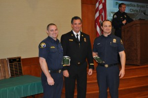 Newport Beach Fire Chief Scott Poster (middle) poses for photos with Kevin Pryor Memorial CERT Instructor of the Year award recipients, paramedics Bryan Carter and Chris Fanti.