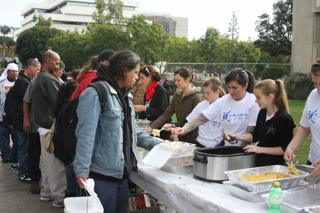 Volunteers dish out food to the needy in Santa Ana on Christmas day.