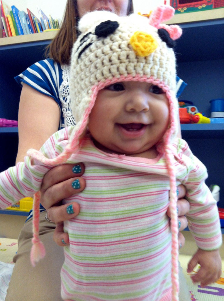 Bella, a patient in the cancer ward at Miller Children's Hospital Long Beach, shows off her handmade cap donated by Knots of Love on Wednesday.