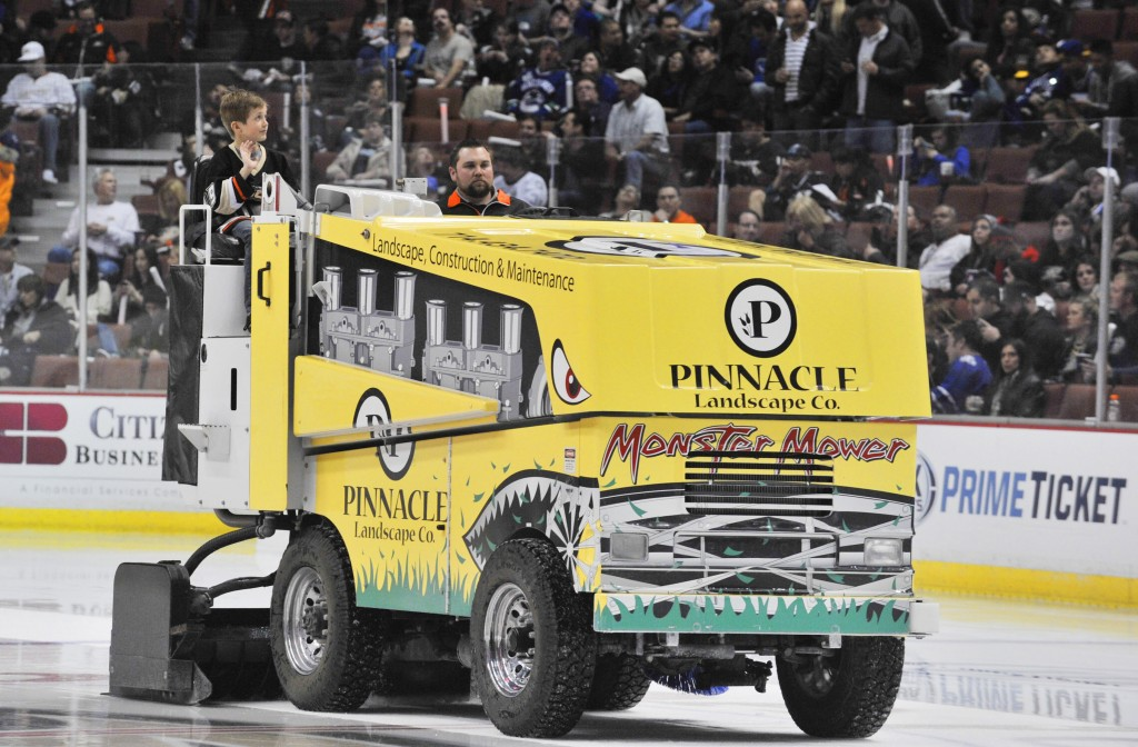 Lucas Marshall of Corona del Mar rides Zamboni during Ducks home opener — Photo by Lawrence Sherwin