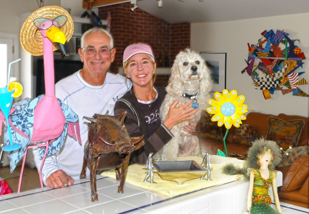 Larry and Julie Sherwin with their dog Bogey in their Corona del Mar home.