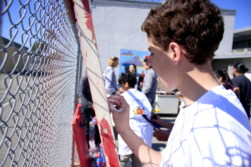 National League of Young Men member Chase Braun works on a door at SOY.