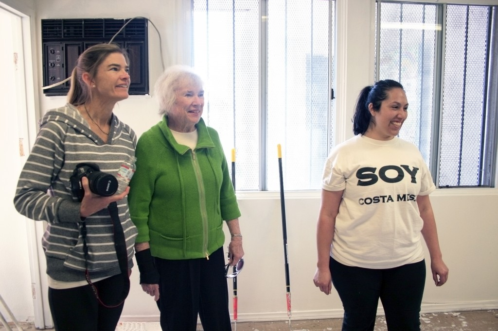 NLYM vice president of philanthropy Vicki Wadman,  SOY board member Jean Forbath, and SOY operations manager Silvia Rosales, check out the progress in the SOY office.