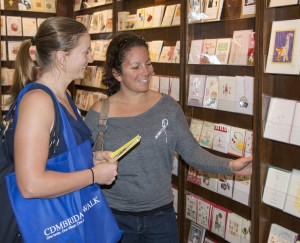 Brides-to-be Jennifer Lawhorn and Erin Mares, of Costa Mesa, who are getting married Sept. 1, check out what Francis-Orr Fine Stationery has to offer during the event.