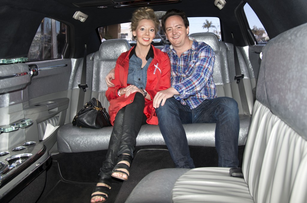 Newport locals Michael Palmer and Bridget Koenig, who are getting married Sept. 1, get a glimpse of the inside of the limo from Sky's the Limit that was offering rides during the bridal walk.