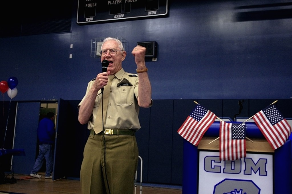 WWII veteran Dick O'Brien cheers on his group of students that dressed up in military garb for the Living History luncheon. — Photos by Sara Hall