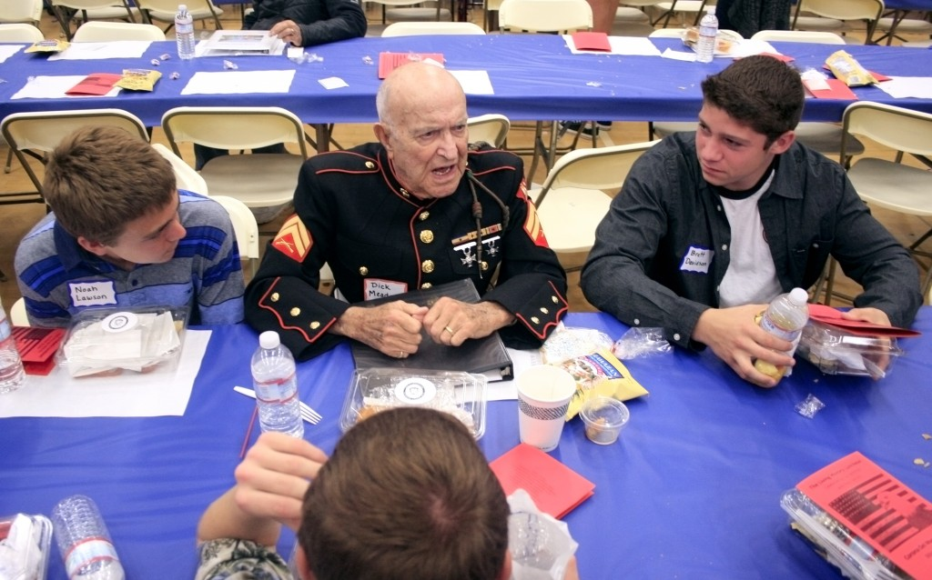 Dick Meadows continues to share stories with his students after the luncheon ended.