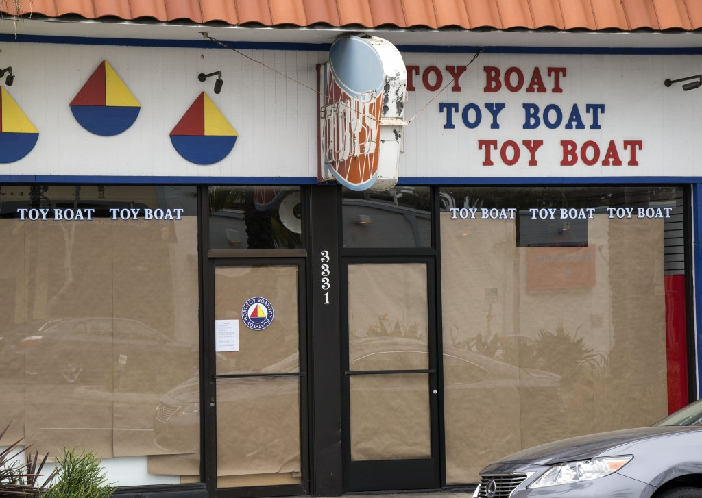 The iconic Toy Boat store in Corona del Mar all boarded up on Monday. — Photo by Charles Weinberg