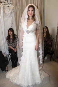 Neda Azarfar tries on a gown at The White Dress in Corona del Mar. Photo by Charles Weinberg.