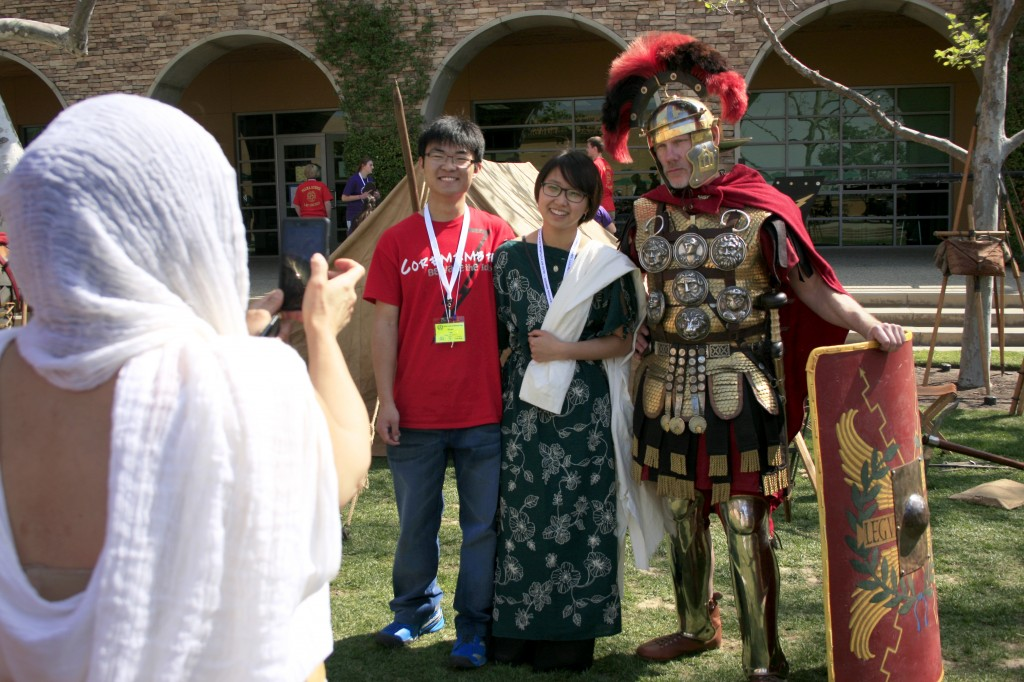 Event organizers Ryan Lee and Yoon Cha pose with a Roman soldier for a photo during the convention.