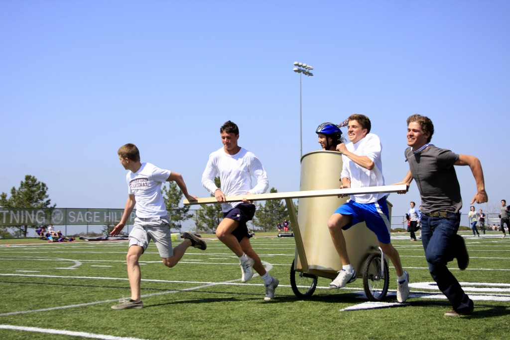 A high school team competes in the chariot races during the Latin festival at Sage on Saturday.