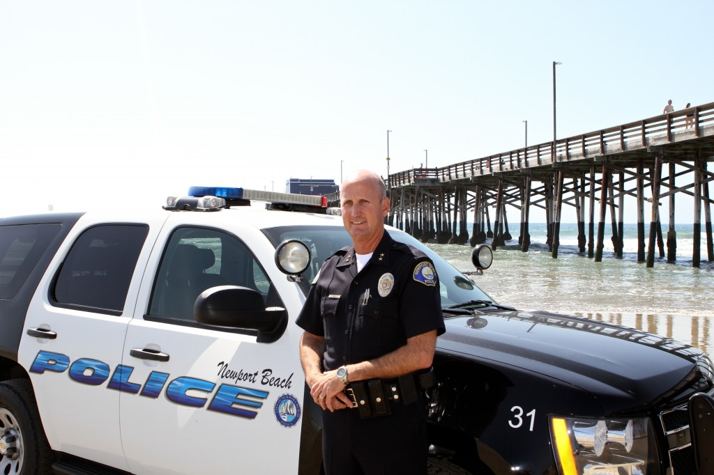 Deputy Chief Dave McGill with his cruiser on the beach. — Photo by Jim Collins