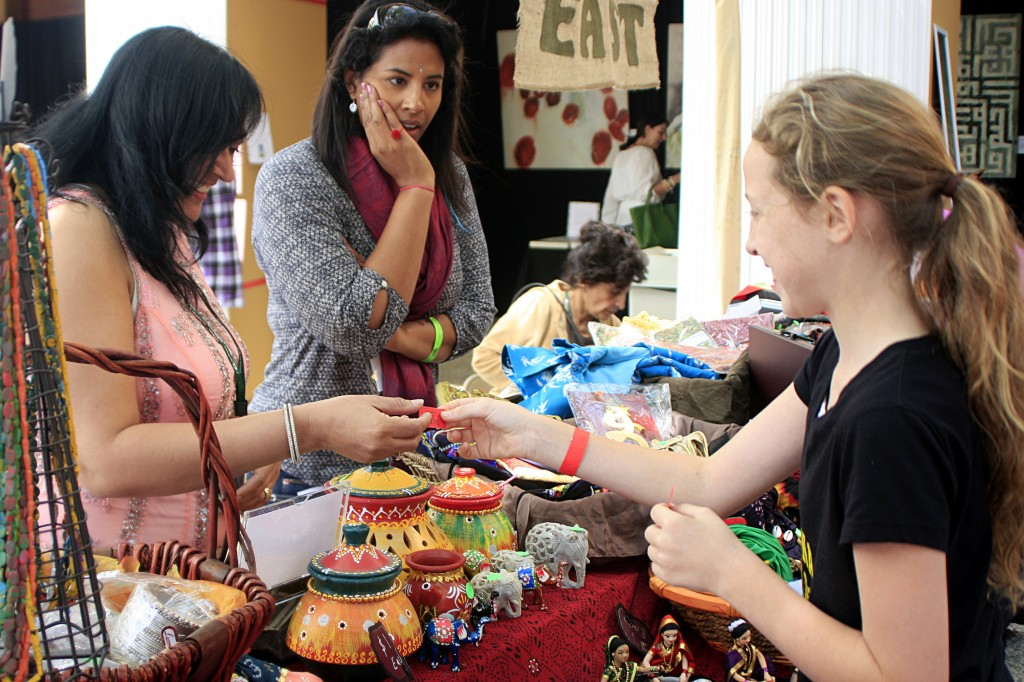 Hannah Woodworth, 12, a student at Marine View Middle School in Huntington Beach, buys a decorative elephant for her friend at the India booth in the Ethnic Bazaar.