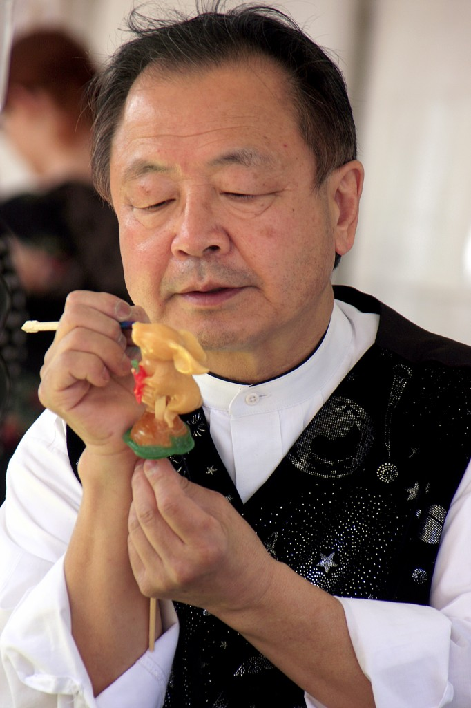 """Shan """"the Candy Man"""" Ichiyanagi, sculpts colored corn syrup into the shape of a rabbit holding a carrot."""