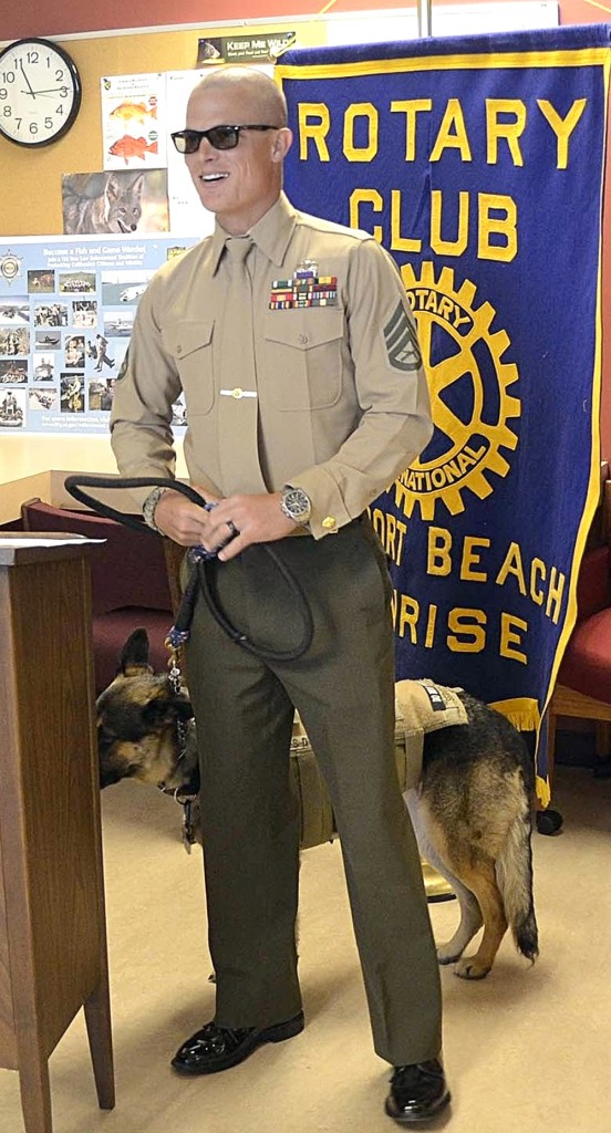 """Wounded Marine warrior, Staff Sgt Darrell """"Wes"""" Rushing. with his guide dog, Gracie, receiving the first discounted fishing license for injured active duty service members, now allowed under the new state law. — Photo courtesy Newport Beach Sunrise Rotary Club"""