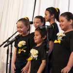Illumination Foundation kids sing for the audience