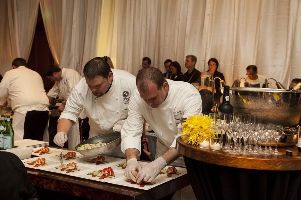 Bambu at The Fairmont Newport Beach Executive Chef Brian Doherty (right) prepares his fifth course of the evening