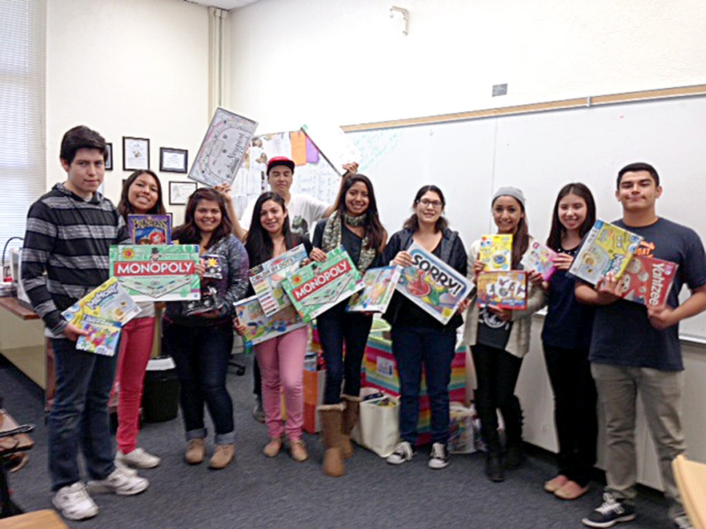 Newport Harbor High School students with some of the games they collected.
