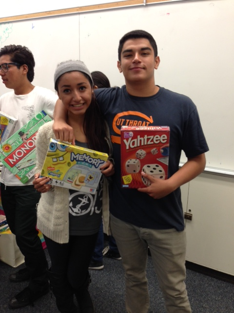 NHHS seniors Maribel Coria and Victor Valladares with some donated games