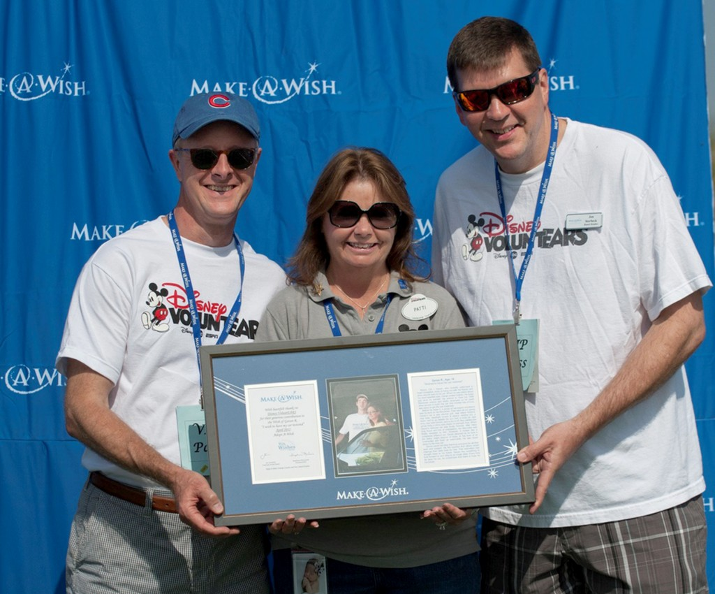 Disney VoluntEARS (left to right) Jeff Larson, Patti Emmerson, Jon Storbeck accepting their plaque for adopting a wish through their team's fundraising efforts — Photo by Dave Klukken Photography