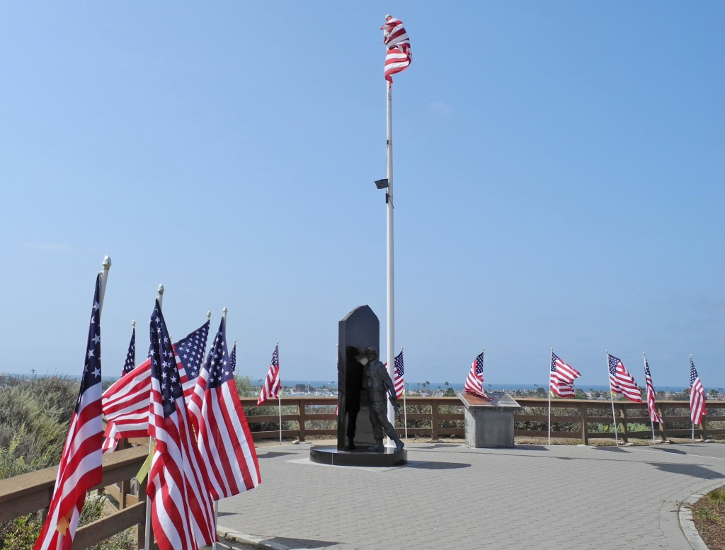Flags and memorial to American soldiers