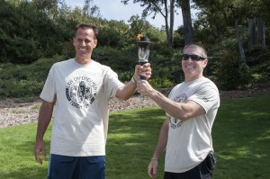 Laguna Beach police hand off the torch to NBPD Chief Jay Johnson.