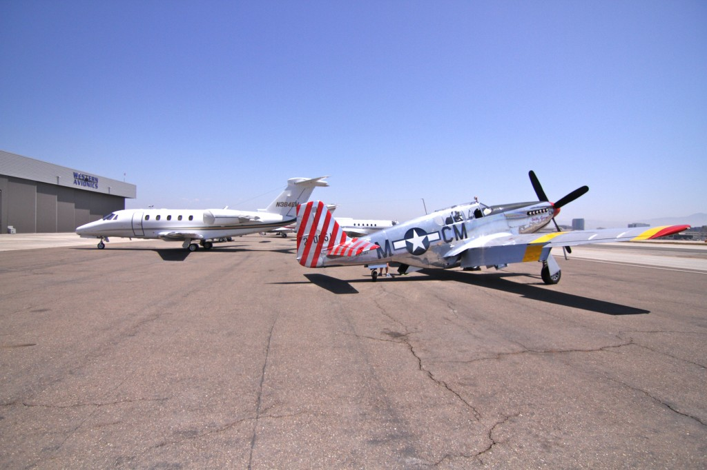 The P51 with a more modern jet at the air field.