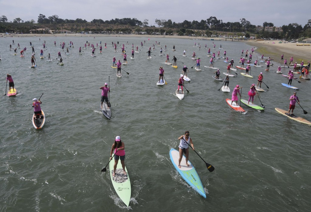 The group of stand up paddle boarders supporting Susan G. Komen Orange County take off at Saturday's Stand Up for the Cure event at Newport Dunes. — Photos by Lawrence Sherwin
