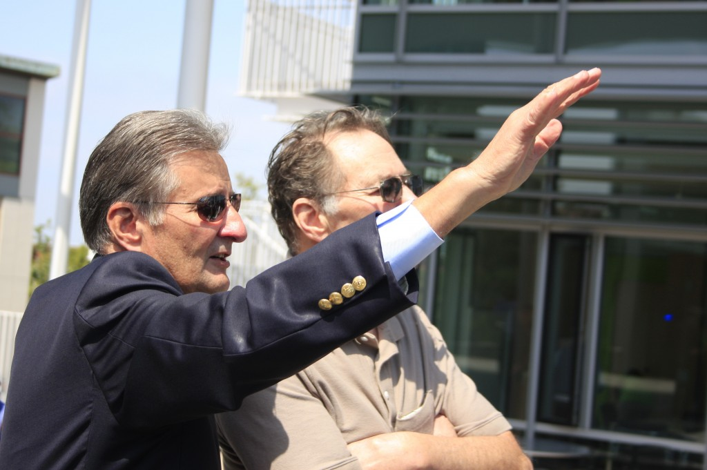 Councilman Ed Selich explains different aspects of the civic center and park to his brother, Dennis, during Saturday's event.