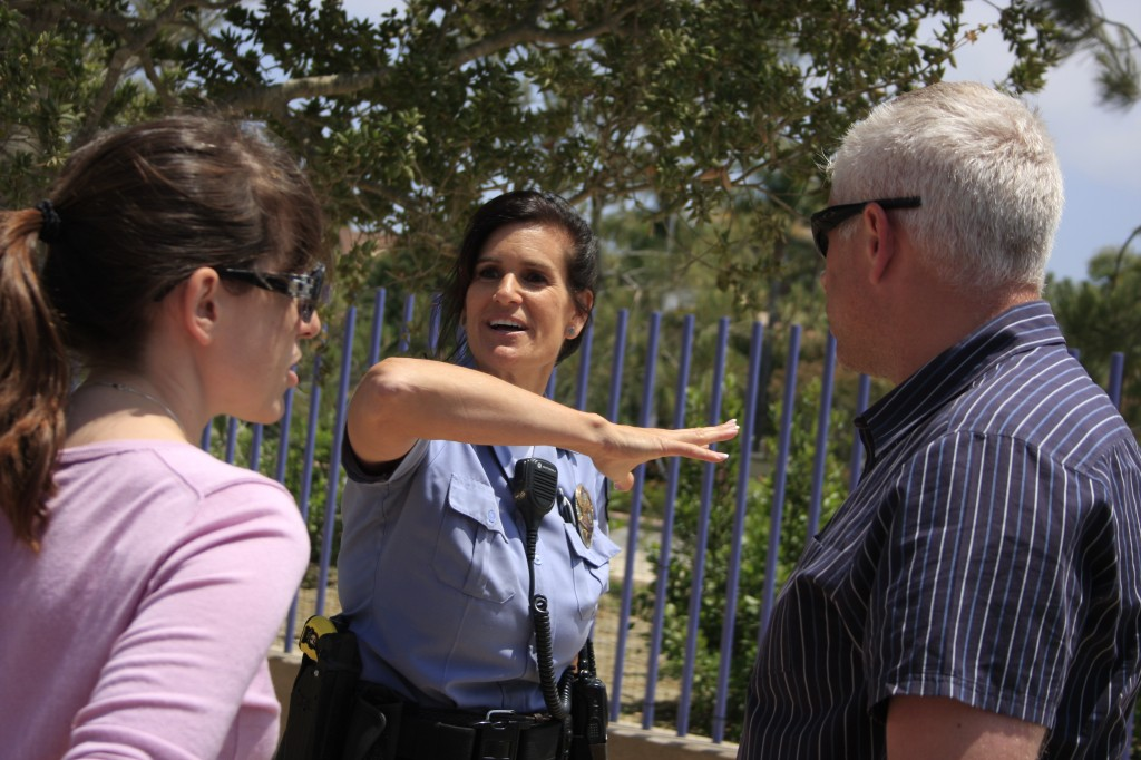Animal Control Officer Valerie Schomburg talks with visitors at the new dog park at the civic center and park event on Saturday. — Photo by Sara Hall