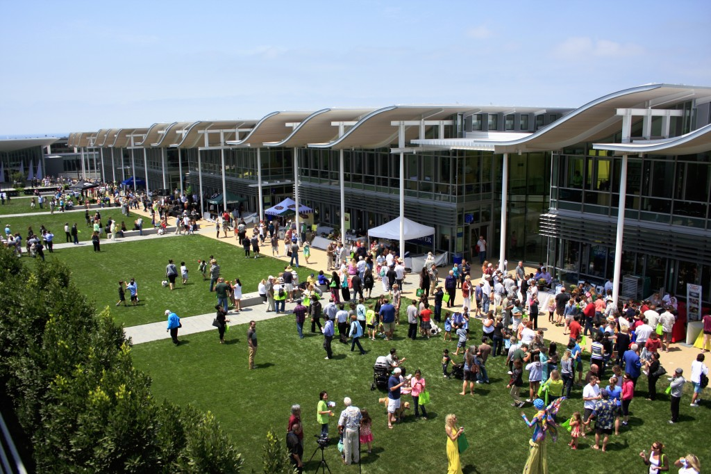 Guests gather on the lawn during a community celebration of the grand opening of the new civic center and park on Saturday. — Photo by Sara Hall