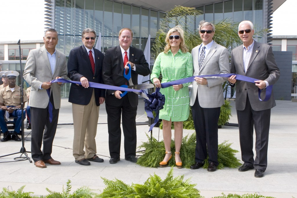 Newport Beach City Council members (left to right) Tony Petros, Ed Selich, Mayor Keith Curry, Leslie Daigle, Mike Henn, and Rush Hill, as the cut the official ribbon during the gran opening ceremony. — Photo by Ann Chatillon
