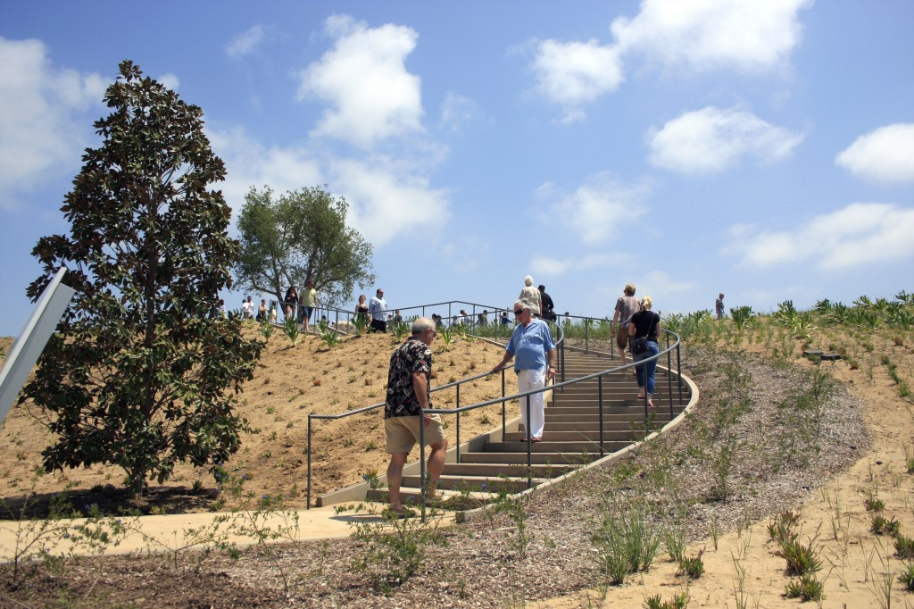 Visitors make their way up some stairs and into the park area of the center. — Photo by Sara Hall