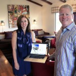 Scott and Jackie Herr in the Corona del Mar home with their Picfari website