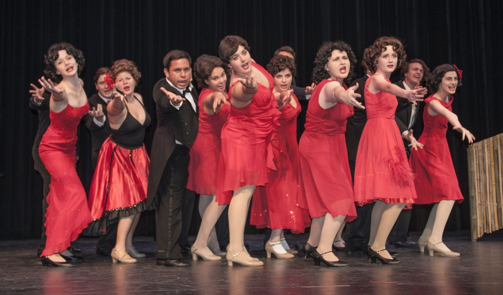 """The ensemble perform """"Hernando's Hideaway,"""" a tango tune from the show."""