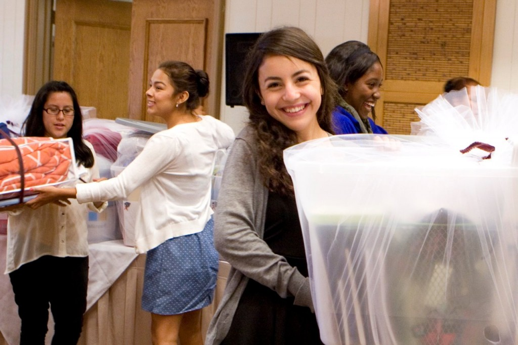 Paula Sanchez happily opens some of the supplies she will take with her to college.
