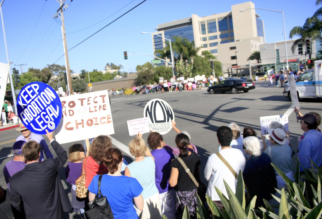 All four corners of Hospital Road and Placentia Avenue were crowded with demonstrators on Thursday.