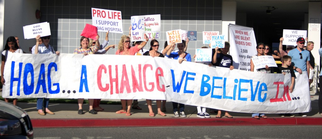 Pro-life demonstrators cheer in support of Hoag Hospital.