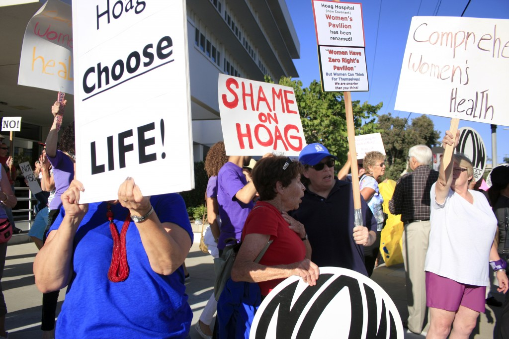 Hoag supporters and protestors gather outside the hospital on Thursday.