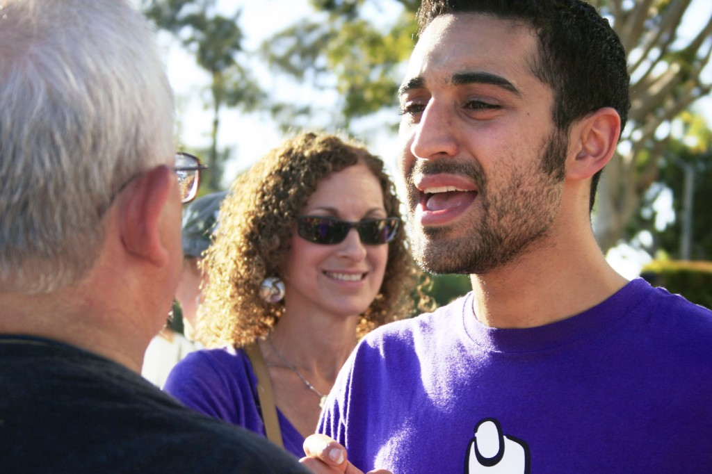 Pro-choice supporter Ethan Simonoff passionately talks with pro-life advocate Len Beckman of Anaheim, as Simonoff's mother, Andy looks on in the background.