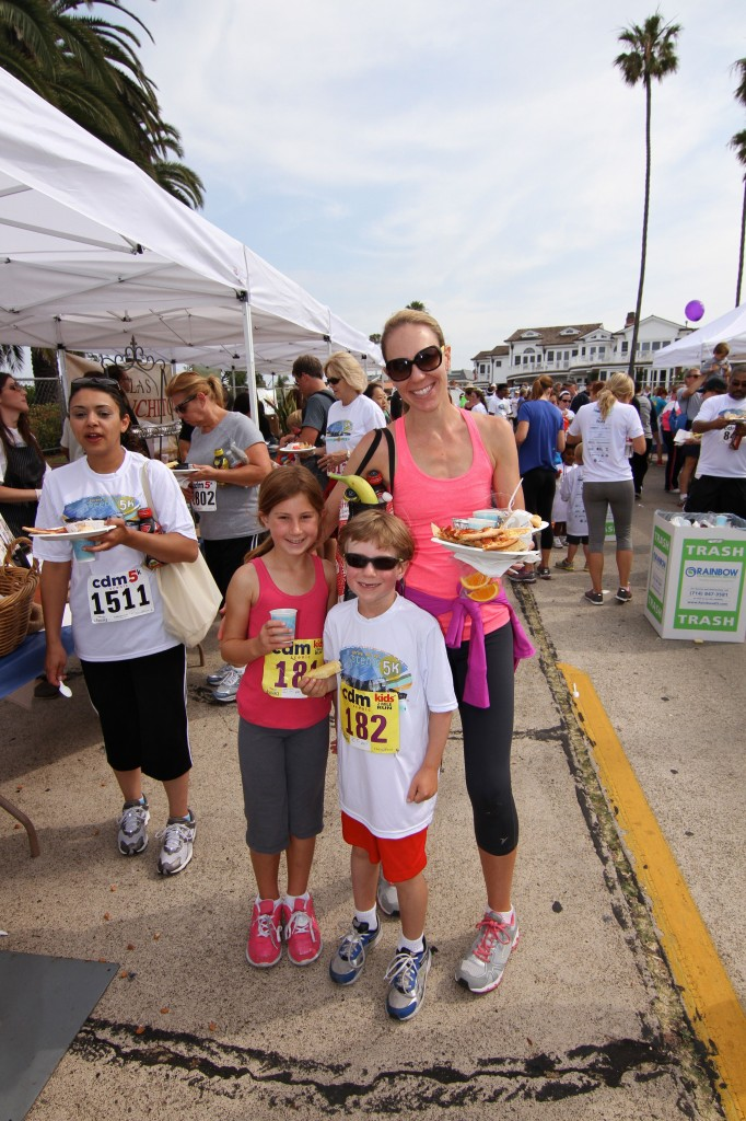 The Yeager family, mom  Sharie,  and kids Chole and Mark, enjoy some food after the race.