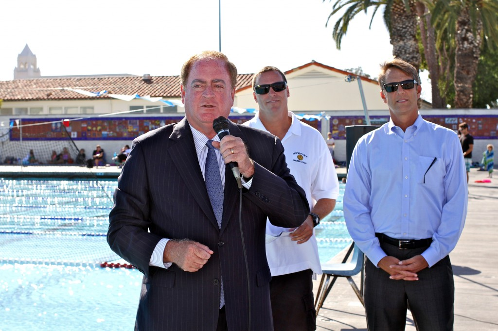 Mayor Keith Curry addresses the Newport Beach Water Polo club on Wednesday while NBWP director and head coach Robert Lynn (background, left) and Newport Aquatics board member James Fowler. — Photos by Jim Collins