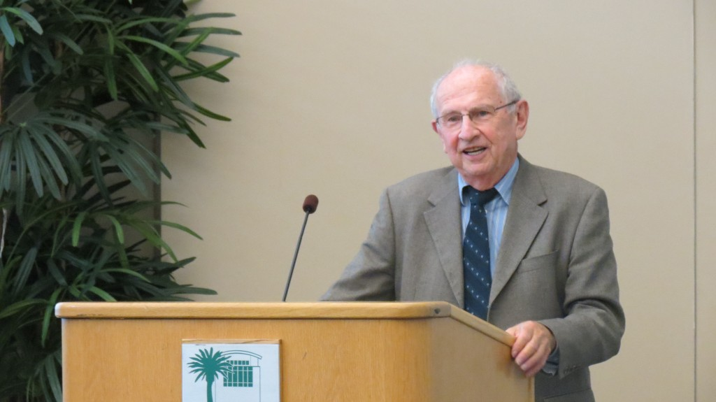 Jack Pariser, 84, of Laguna Beach, talks about his experience as a Holocaust survivor during Monday's opening event at the library.