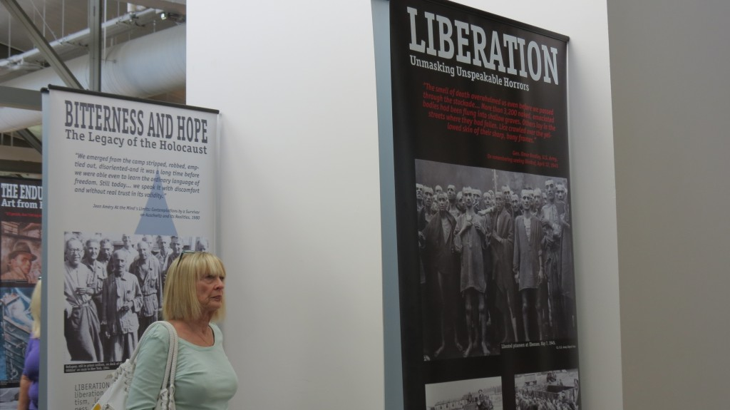 A visitor views photos and narrative from the Holocaust on display at the library.