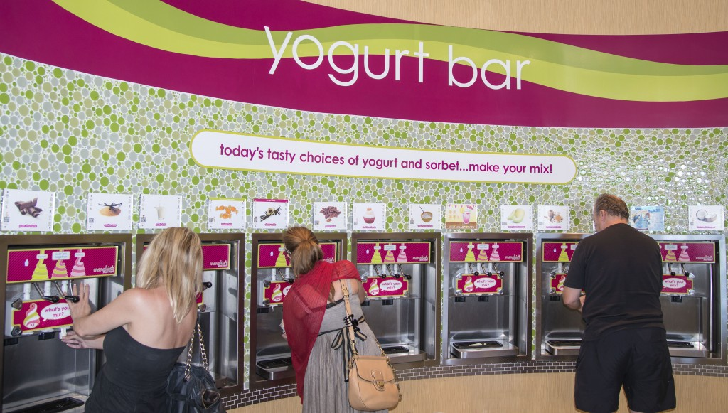 Customers choose their flavor at the new Menchie's Frozen Yogurt store that recently opened in Newport Coast. — Photos by Charles Weinberg