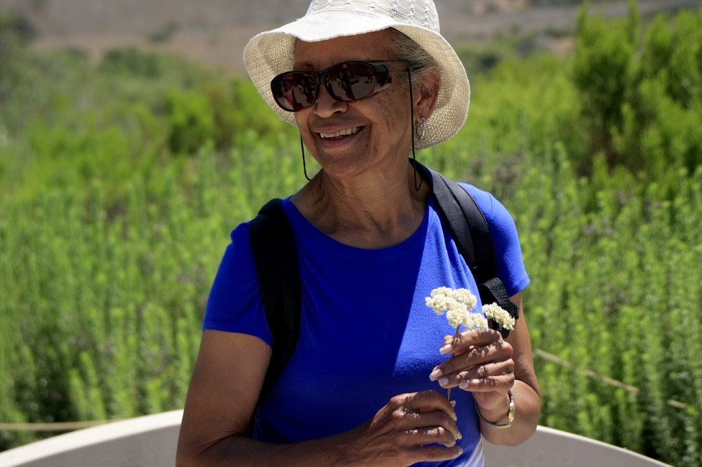Lauretta Herndon smiles as she learns about the native flora found along the loop.